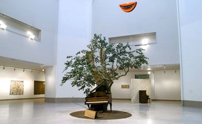 piano in front of tree in an atrium
