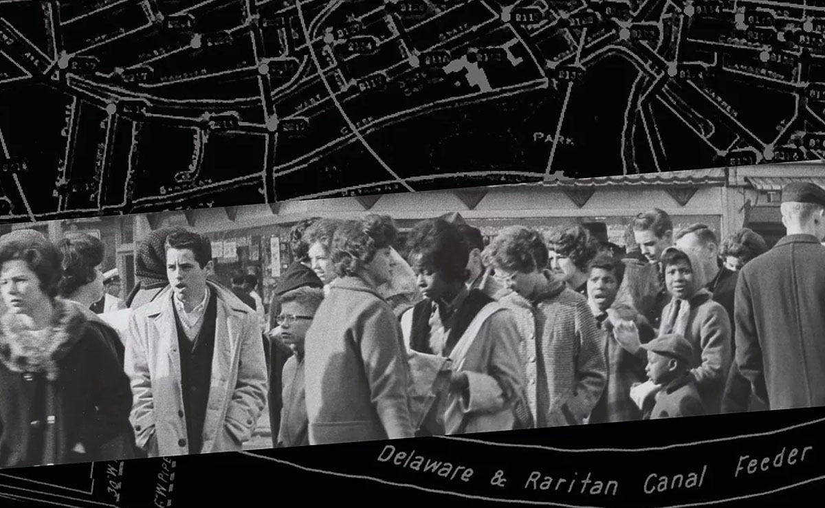 Image of crowd over a black and white map of trenton